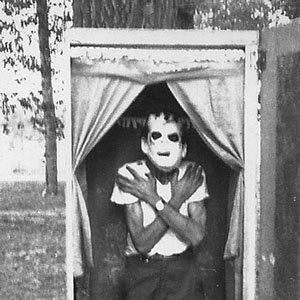 Ben Taylor Standing in Coffin with Frankenstein Mask On, 1970